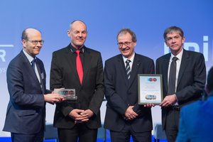"""<div class=""""bildtext_en""""> Renzo Simoni (former CEO of AlpTransit Gotthard AG, 2nd from the left) and Peter Jedelhauser (SBB, 2nd from the right) received the 2018 European Railway Award in Brussels on behalf of everyone involved in building the Gotthard Base Tunnel and putting it into operation</div>"""