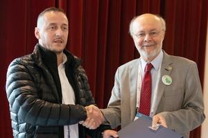 """<div class=""""bildunterschrift_en""""><span class=""""zahl_bildunterschrift"""">12</span>President Celestino (on the right) welcomed Albania as a new ITA member nation</div>"""