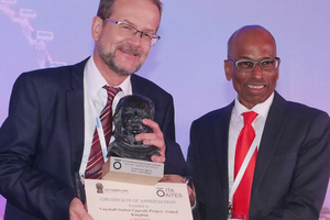 11)&nbsp;&nbsp;&nbsp; Kurt Zeidler (on the left) accepts the ITA Award from Leslie Pakianathan (on the right) for the Vauxhall Tube Station Extension in London <br />