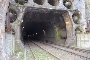 "<div class=""bildtext_en"">The ventilation system behind the freestanding, protected portal of the old Kaiser Wilhelm Tunnel, which is now being modified for single-track traffic </div>"