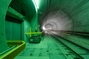 """<div class=""""bildtext_en"""">Every 300 meters a cross duct connects the two tunnel tubes. A solid fire protection door protects the cross passages. In case of fire trains passengers can escape through the cross passages into the other tube. The control system activates the escape signals and uses the doors to expel smoke 