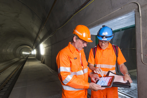 "<div class=""bildtext_en"">Peter Müller, Siemens Project Manager for the Tunnel Control System (left) and Raoul Harlacher, Project Manager of Transtec Gotthard (right) in front of an emergency exit in the Gotthard Base Tunnel's Faido Multi-Function Station</div>"