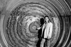 James S. Robbins stands in front of an early TBM excavation face showing kerf cutting