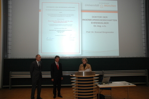 "<div class=""bildtext_en"">President Prof. Merith Niehuss presents Prof. Konrad Bergmeister with the honorary doctorate</div>"