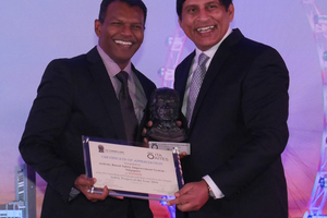 8)&nbsp;&nbsp;&nbsp;&nbsp; Edward Raj (on the left) from the Singapore Power Grid receives the prize for the best safety initiative from TUCSS president Kulaindran Ariaratnam (on the right) for ABSIS <br />