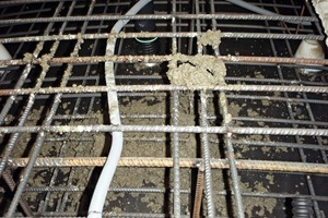 "<div class=""bildtext_en"">Grouting hose laid in the segment reinforcement during concreting</div>"