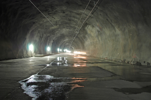"<div class=""bildtext_en"">View of the 15 km long roughwork tunnel at Mitholz–Ferden. This carcass tunnel without rail technical engineering is accessed by road vehicles for service purposes</div>"
