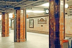 "<div class=""bildunterschrift_en"">The Fehrbelliner Platz Station in Berlin is protected. Floor tiles as well as the yellow-green tiles above provided with a dark-brown ceramic frieze, still exist in their original state</div>"