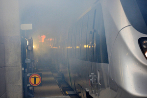"""<div class=""""bildtext_en"""">Leipzig City Tunnel - full-scale fire protection drill with simulated tunnel fire</div>"""