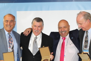 "<div class=""bildtext_en"">TTS award: Levent Özdemir (otl), Dr. Güner Gürtunca (2<sup>nd</sup> from left) and Prof. Nick Barton (otr) were honoured for their long-standing services in various spheres of tunnelling</div>"