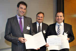 "<div class=""bildtext_en"">Awarding the 2012 Traffic Safety Prize (from l. to r.): Dr.-Ing. Dirk Boenke, section head Martin Friewald in charge of ""land transport"" in the Federal Ministry of Transport (BMVBS), Dr. Sebastian Poschadel</div>"