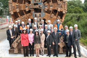 "<div class=""bildtext_en"">Tunnel completion ceremony, 14 June 2012</div>"