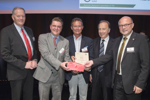"""<div class=""""bildtext_en"""">Professional mineralogist Eugen Kleen (centre), Head of Research &amp; Development in Mineral Construction Materials and Concrete Additives at MC-Bauchemie, and Norbert Hörlein (second from the left), Project Manager at Porr Bau, received the Innovation Award from Prof. Dr. Robert Galler (right) </div>"""